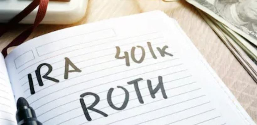 IRA 401k Roth written in a book