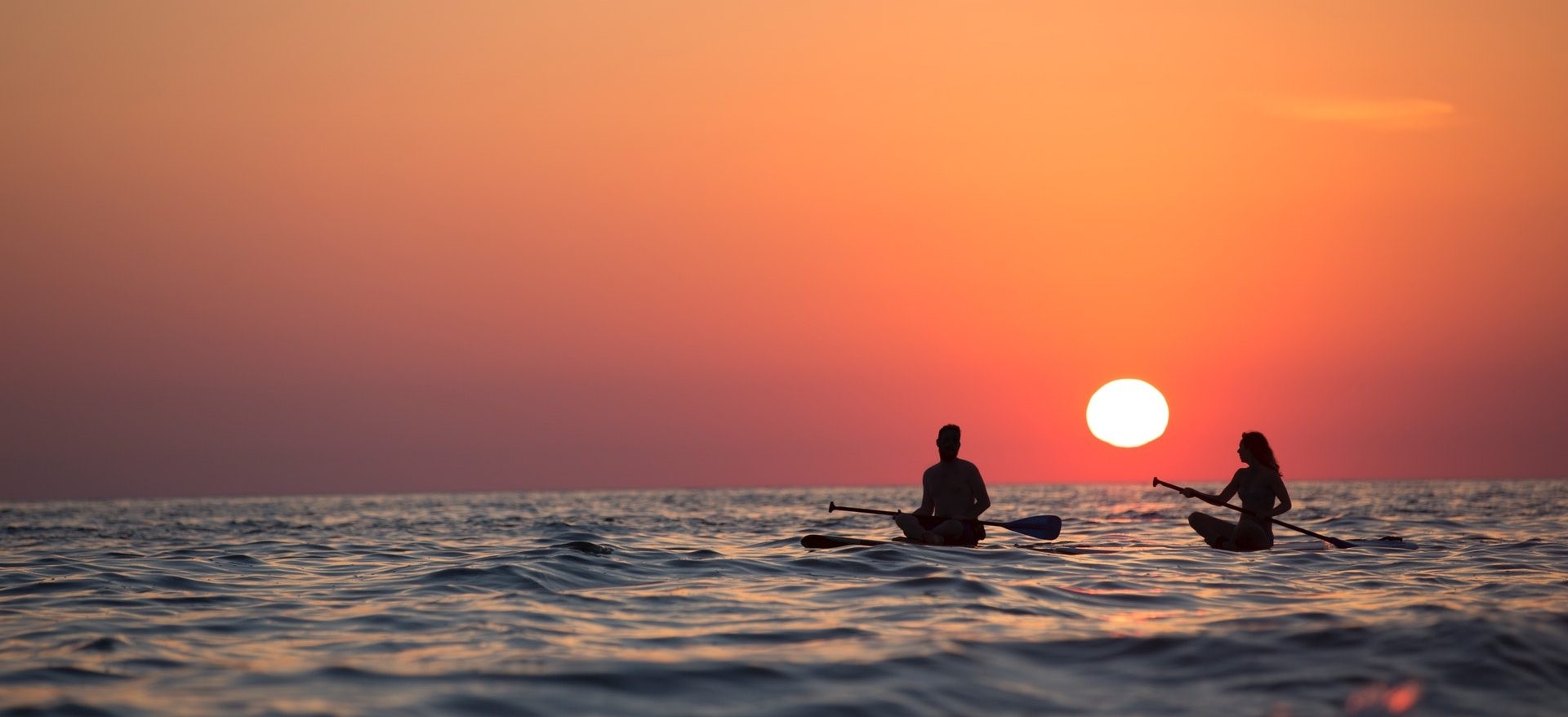People kayaking in a sunset