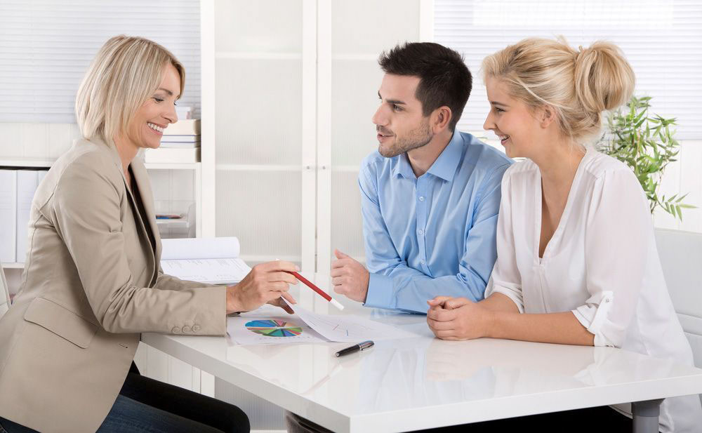 Financial advisor working with clients