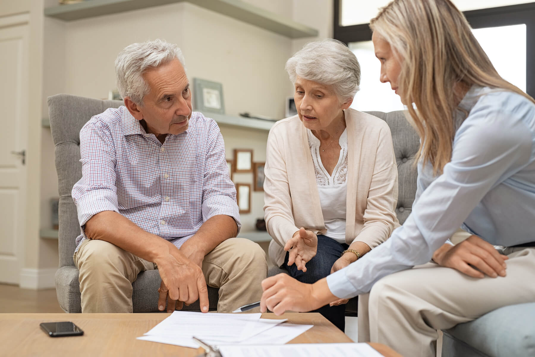 Retired couple looking over NUA paperwork with financial advisor