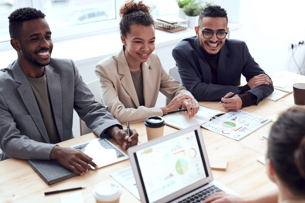 Canva Photo of Three People Smiling While Having a Meeting 1 | Bogart Wealth