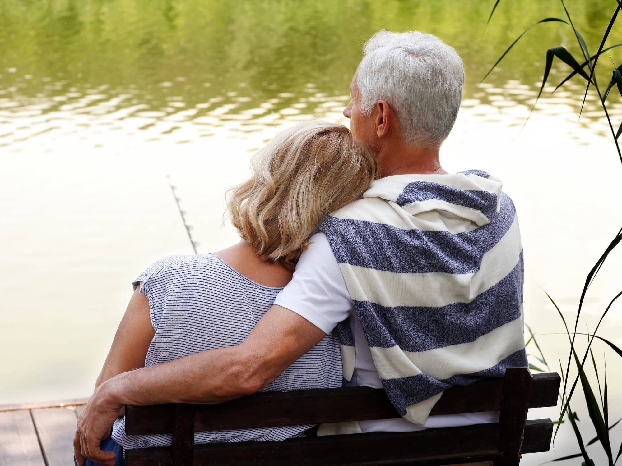 Senior couple sitting at a lake