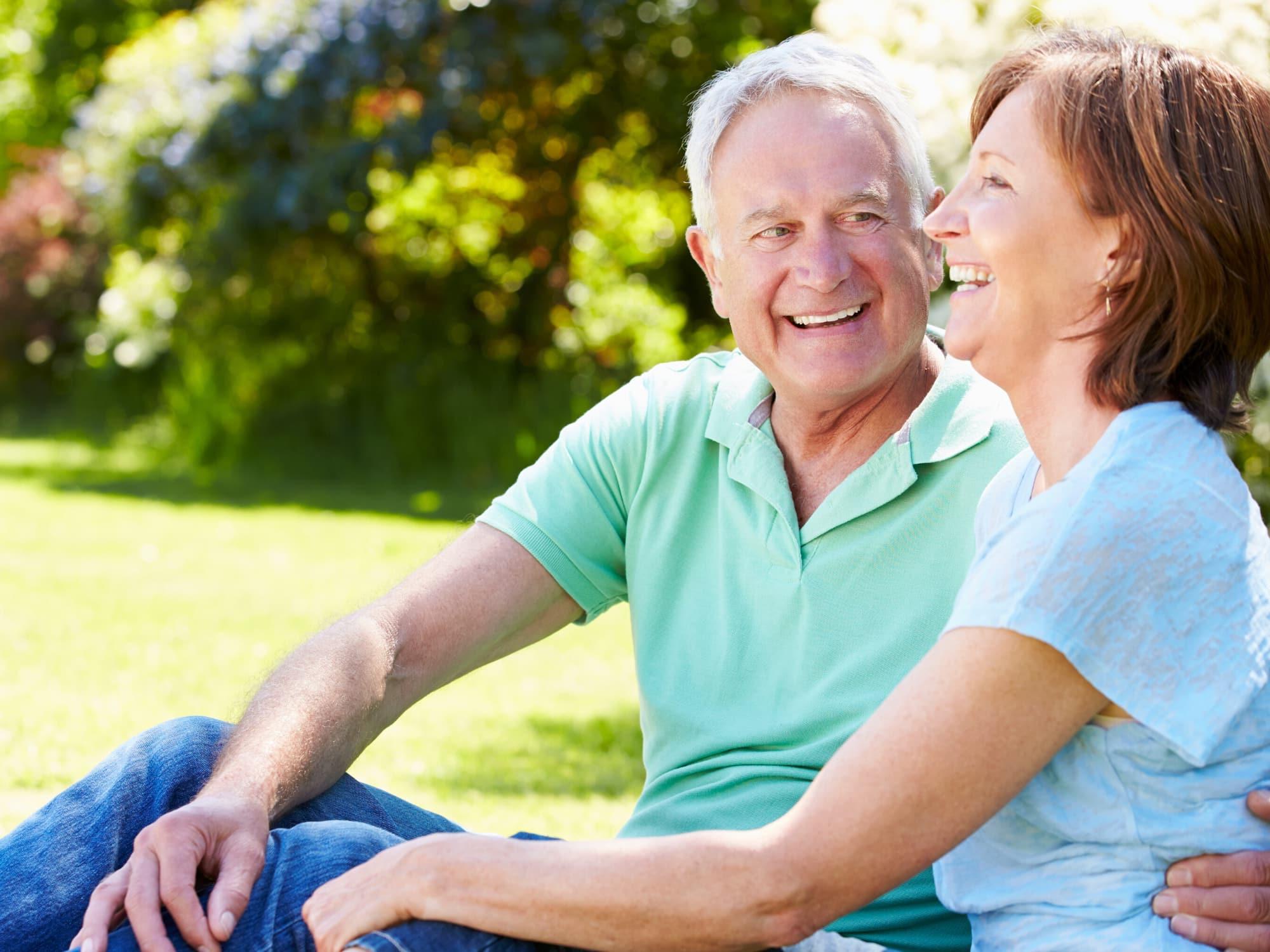 Senior couple sitting outside