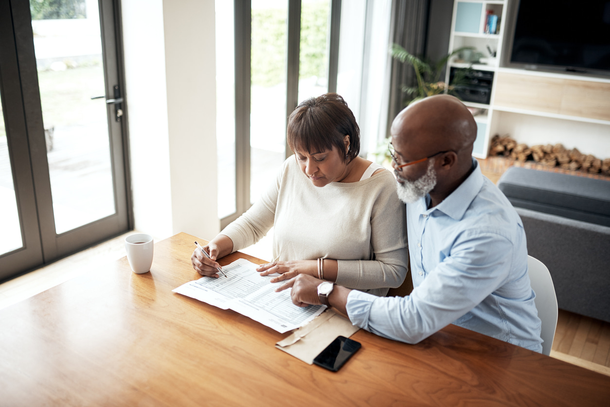 couple looking over a 401k; retirement plan. Rolling over a 401k