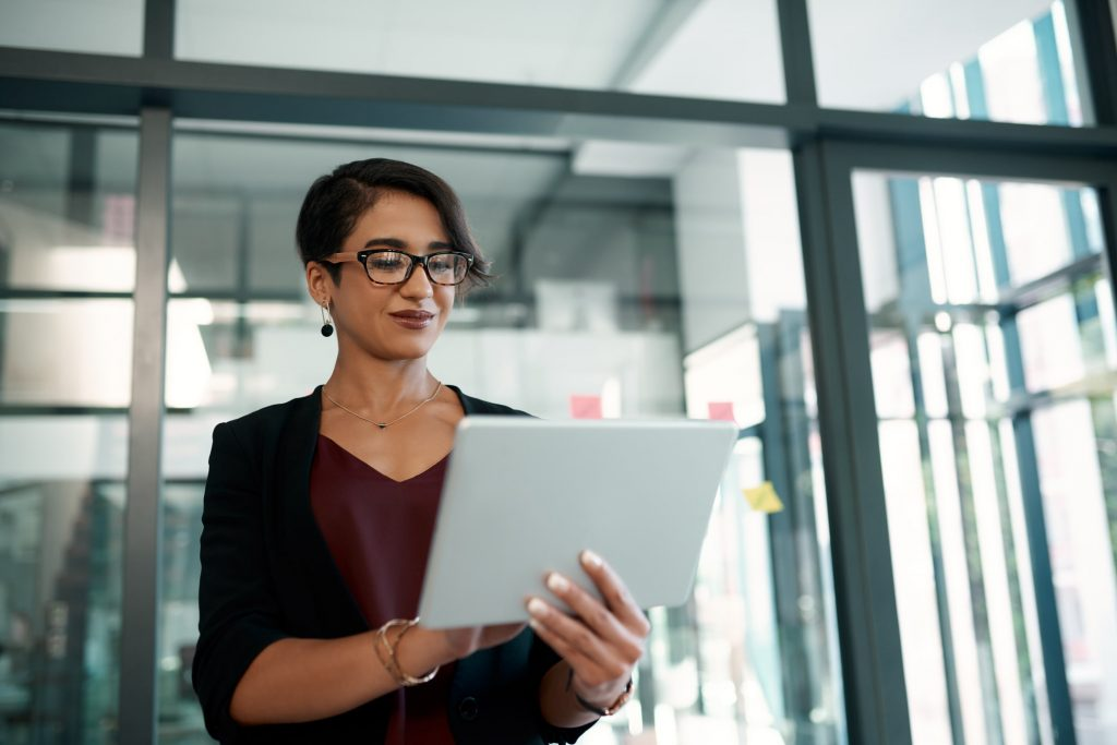 Woman looking at an ipad in an office
