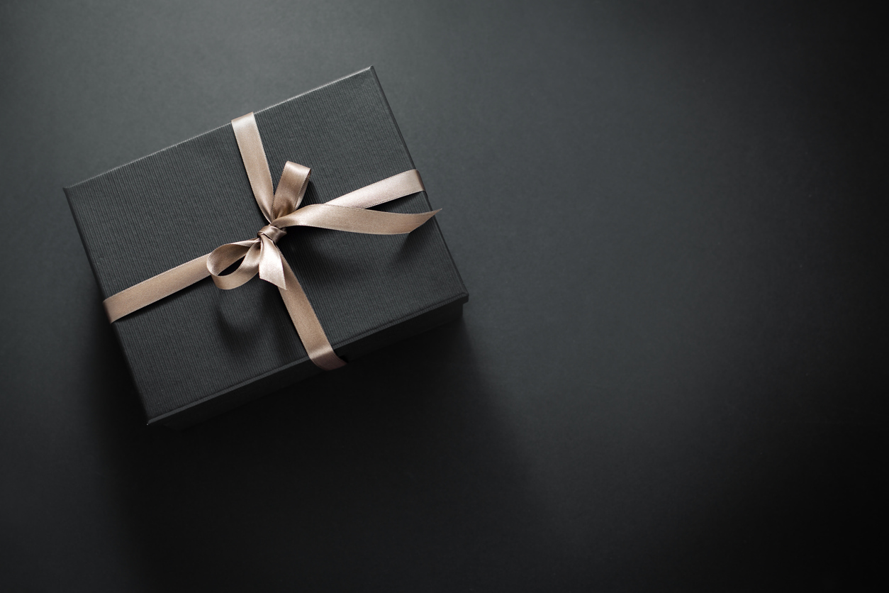 A wrapped present of stocks as gifts