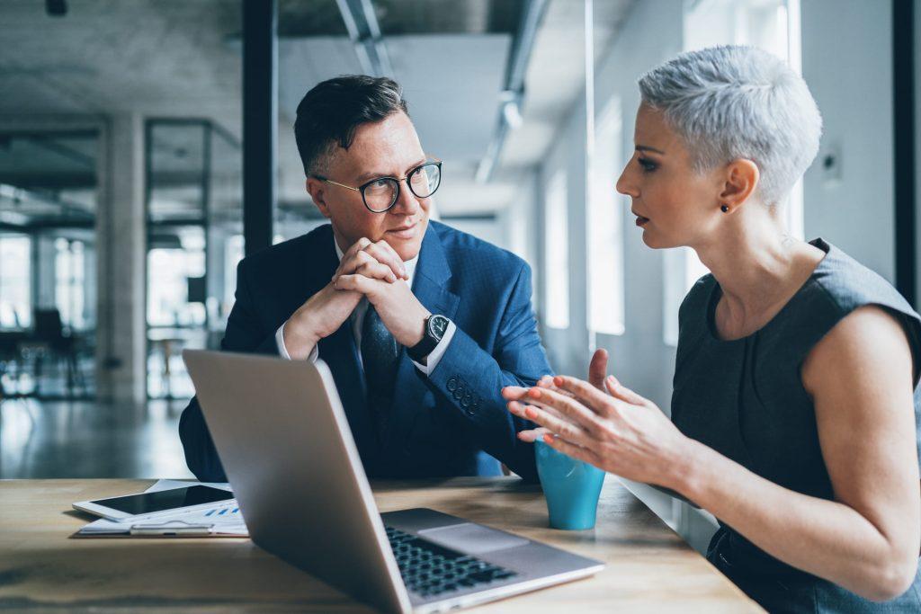 Financial advisors working on rebalancing portfolio