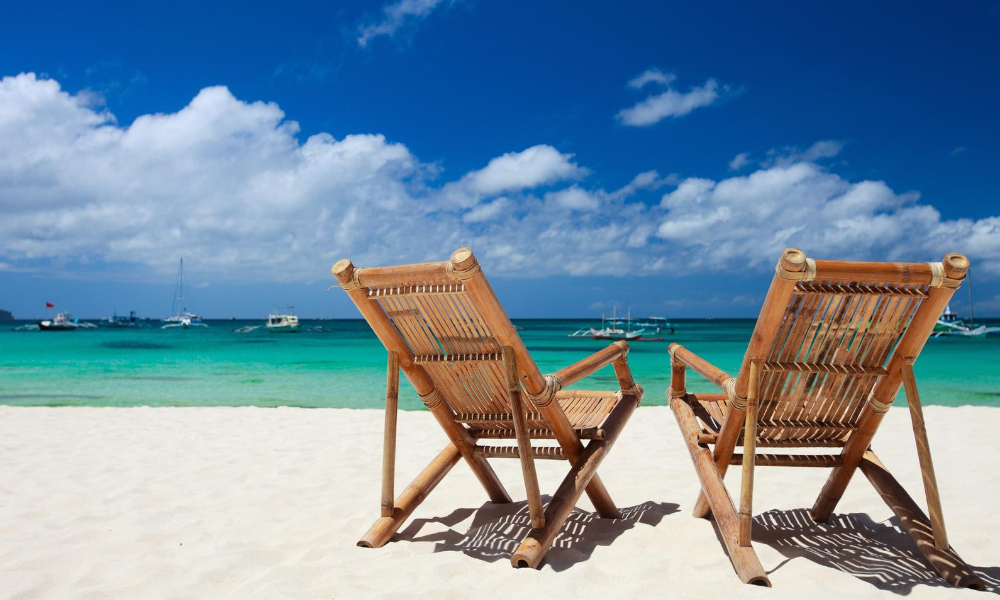 Chairs on a beach, symbolizing Retiring abroad tax implications