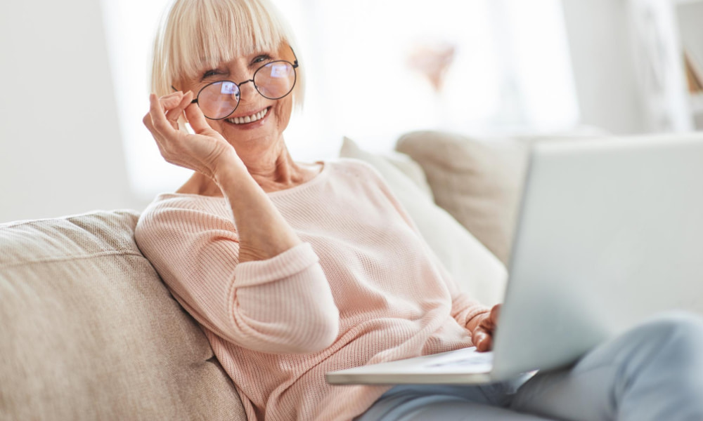 Woman on couch after she completed the 5 things to do before you retire.