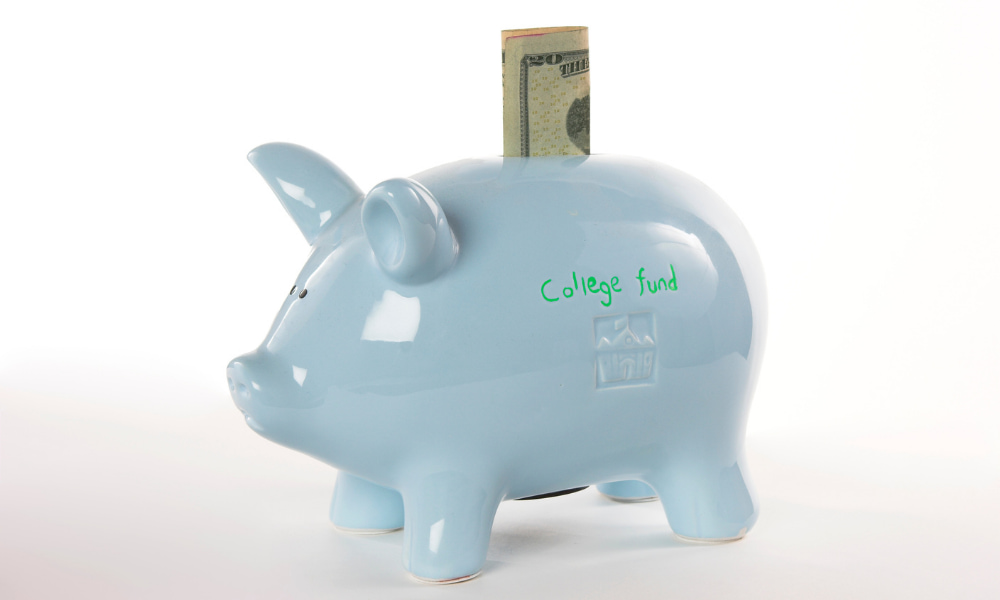 Piggy bank with money hanging out from a person Financial Planning for College