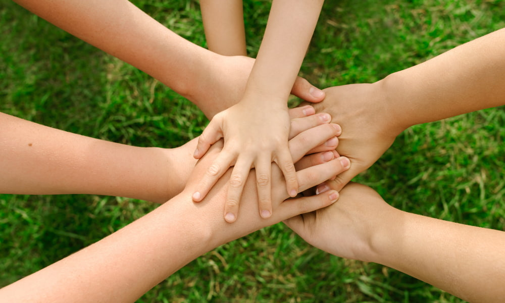 hands together symbolizing a commingled fund