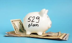 529 plan written on a piggy bank