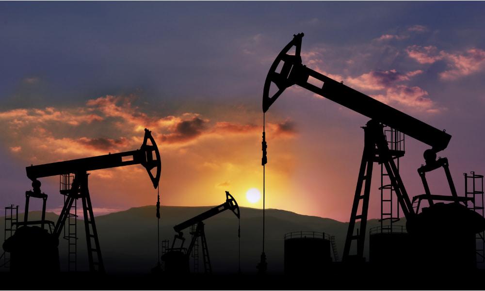 oil drill in sunset