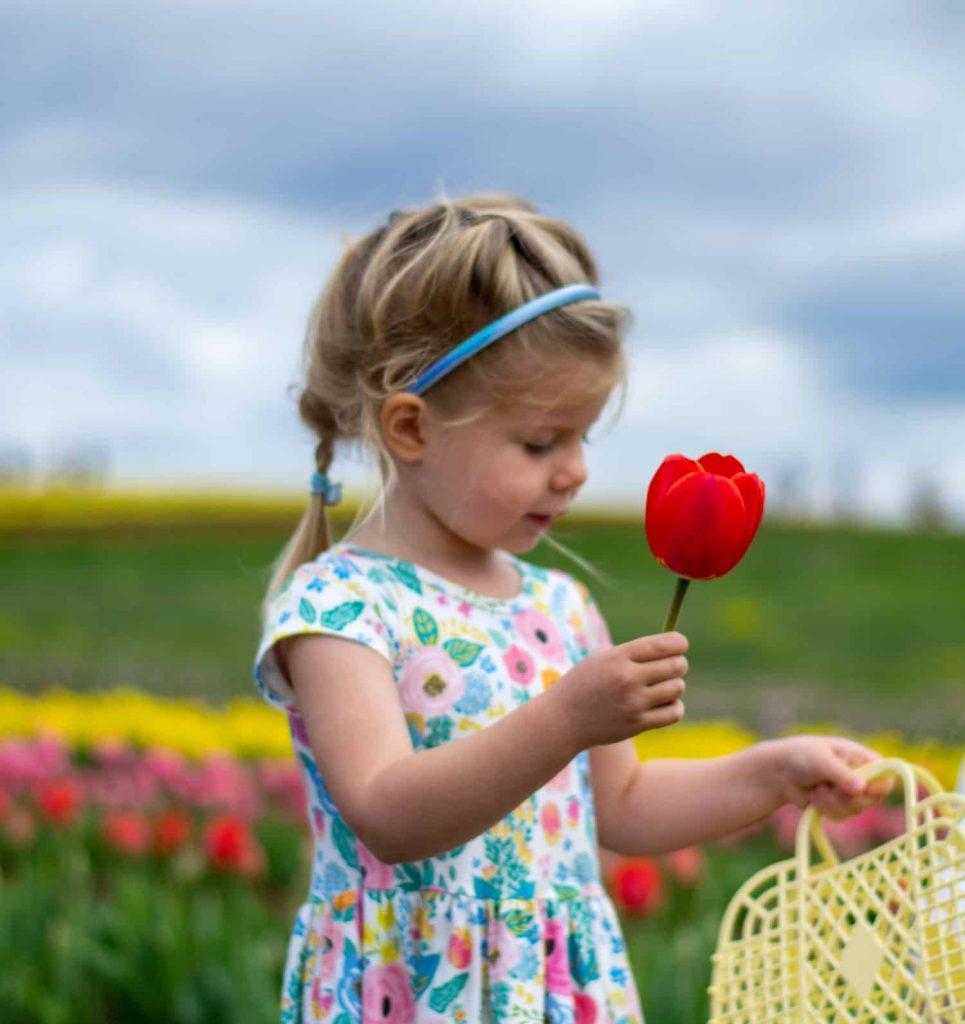 Makenna smelling Flower e1619114913138   Bogart Wealth