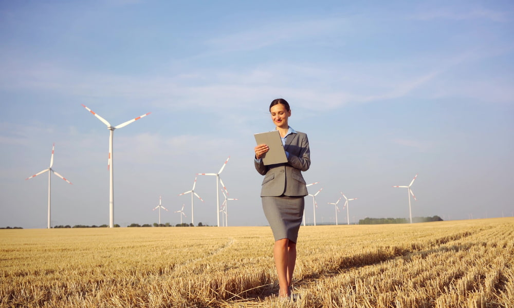 person in front of windmill
