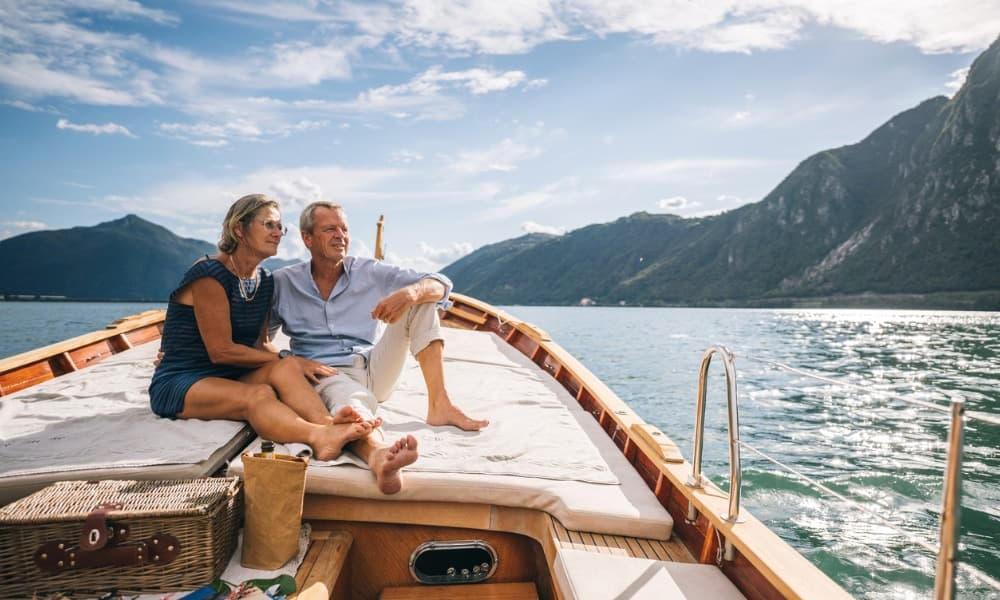 A couple enjoys life on a boat because they made a budget for retirement when they were younger.