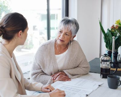 A woman asks about bequests and makes an estate plan with her wealth management advisor.