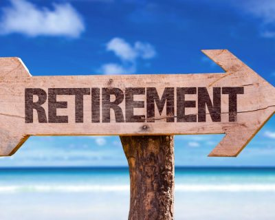 Sign on a beach for retirement. To show you the tax implications of retiring abroad.