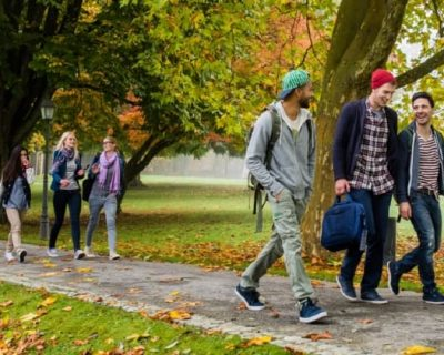 Kids walking on a college campus