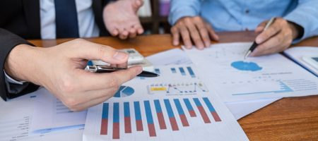 Financial planner showing stats to a client