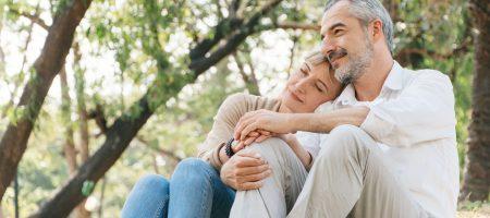 senior-elder-caucasian-couple-sitting-on-ground-together-in-park-wife-resting-head-on-husband_t20_KvnGVK (1)