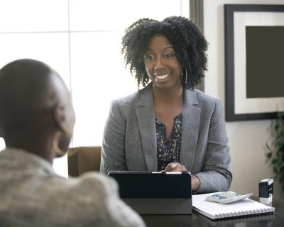 A tax preparer consulting with client.