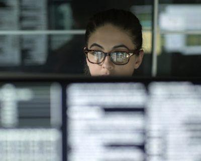 person looking at international stocks