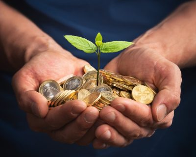 Person growing money and plant from ESG Fund
